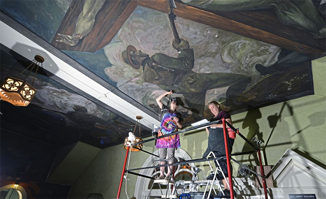 Conservators work to preserve Maxo Vanka's murals with an invisible hand