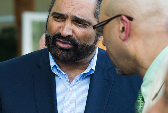 Endowments President Grant Oliphant speaking to Board Member Franco Harris at Phipps Conservatory.