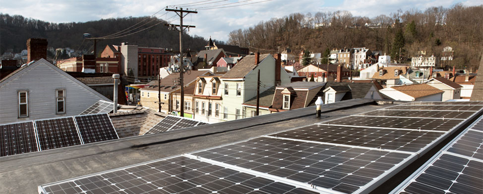 View from the roof of the Millvale Community Library, where they have installed enough solar panels to provide more energy than they can use. Houses and building of the boro are visible in the background.