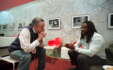 Two men sitting and talking during the family engagement celebration at the Children's Museum of Pittsburgh.