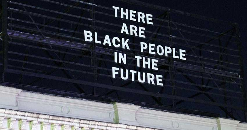 "Billboard sign at the top of a building that read, ""There are black people in the future."""