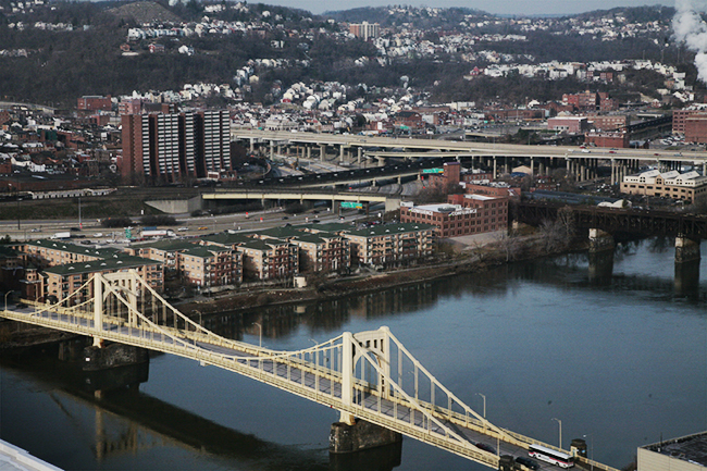 Image of the North Shore taken from Downtown, with the Allegheny River and the bridges in the foreground.
