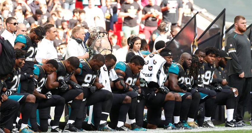 NFL players kneel in protest during the national anthem at the Jacksonville Jaguars vs Baltimore Ravens game.