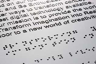 Image that shows text at the top and braille underneath