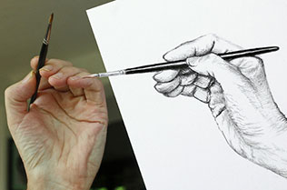Image of a hand holding a paintbrush and a drawing of a hand holding a paintbrush